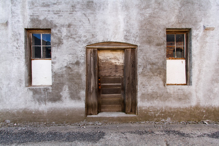 Horizontal Photo of a background of a backdoor and windows to an abandon building