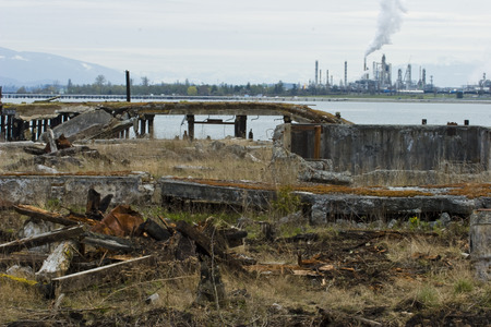 Photo of Industrial Wasteland with manufacturing plant in background. Stock Photo