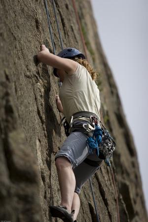 Photo of woman rock climbing