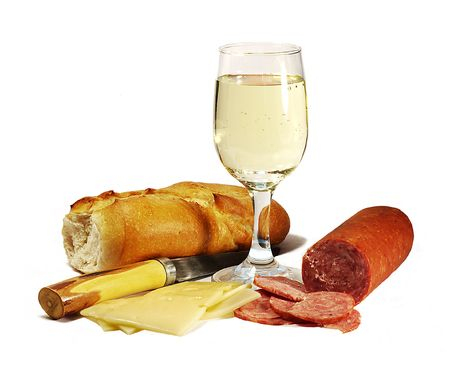 bread and wine: salami, french bread, wine, cheese and slicing knife
