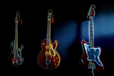 photomanipulation: Digitally generated colorful glowing electrified guitars on dark background