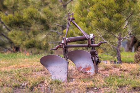 Old rusty antique vintage farm plow equipment