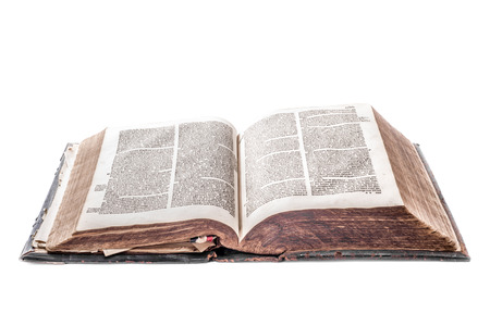 Old Dutch Bible, over three hundred years old, on white background photo