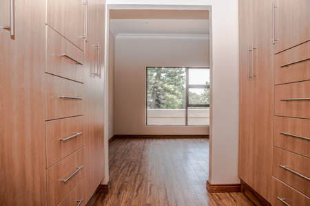 walk in closet: The dressing area of a newly build house that is up for sale.
