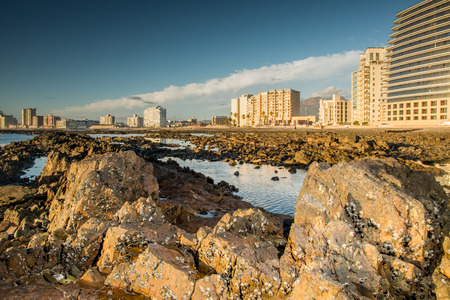 somerset: Rocky beach at Somerset West with a view to the city scape at low tide