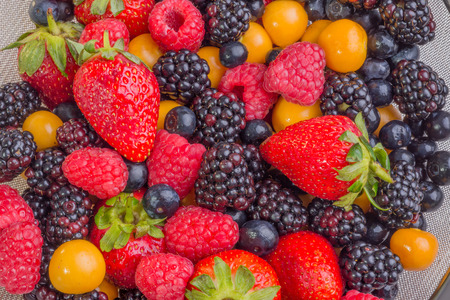 Up Close view of fresh berries of different types, all mixed together.