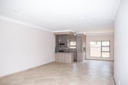 vacant: A vacant living room of a newly build home with the kitchen in the background. Stock Photo
