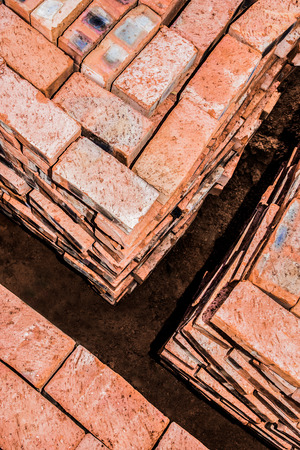 neatly stacked: Bricks neatly stacked in square stacks by the building site. Stock Photo