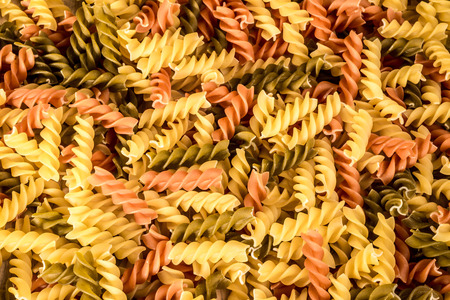 fussili: Background image of three different colours of fussili pasta.