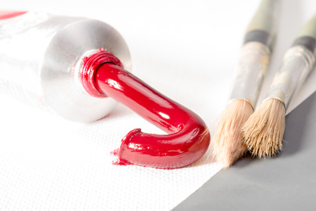 permanent: Permanent Alizarin Crimson oil paint pressed out of the tube on to white canvas. Stock Photo