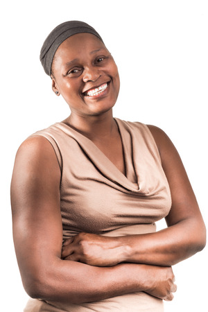 midlife: Three quarter portrait of an African lady, in her early fourtees, with a big beautiful smile on a white background. She wears a light brown sleeveles top and a grey head cover.