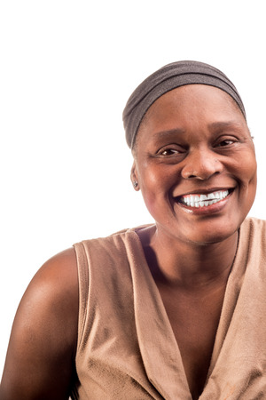 midlife: A portrait of a happy and friendly woman on an isolated white background.