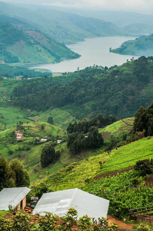 kisoro: A view of Lake Bunyonyi as  the family, in the house right below, views it every day, from over their agricultural land, high up in the hills in the south of Uganda.