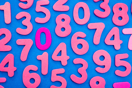 Pink single digit numbers placed randomly over a blue background