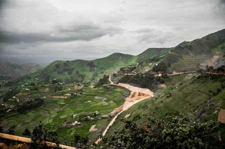 A view of the landscape in the Kibale district in Uganda near the border of Rwanda reveal subsistance farming from the bottom to the highest points of the hills and valleys. Stock Photo