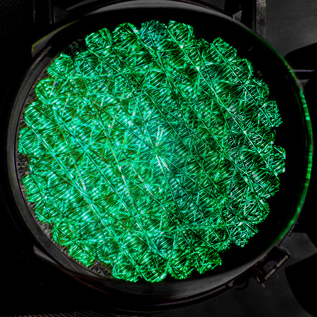 trafic: An up close view of a green trafic light, which makes use of LED technology, as it is turned on