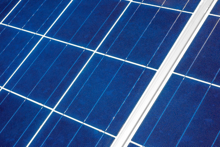 gass: An up close view of a solar panel revealing the squares within which the individual solar strips are positioned as seen from a diagonal angle.