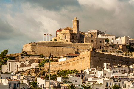mediteranean: The cathedral Santa Maria is viewed from the Mediteranean sea in the early morning as it sits above the old town of Ibiza Stock Photo