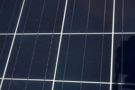 electrochemical: An upclose view of the grids and square shapes of a solar panel.