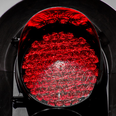 trafic: Trafic Light powered by LED lights, shining red while viewed up close.
