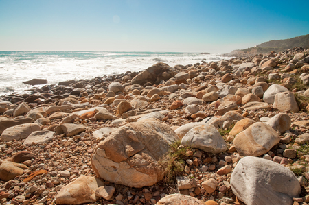 capetown: A rocky beach on the Atlantic ocean near Camps Bay, Cape Town.