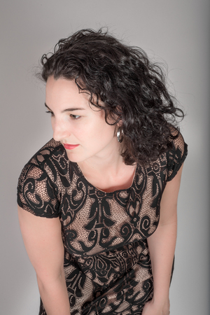 mid twenties: Young model in her mid twenties in a black dress. Stock Photo