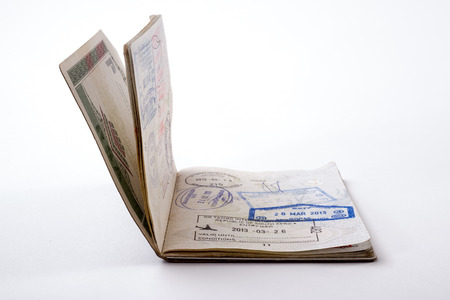 A Passport with stamps and dates on a white background. Standard-Bild