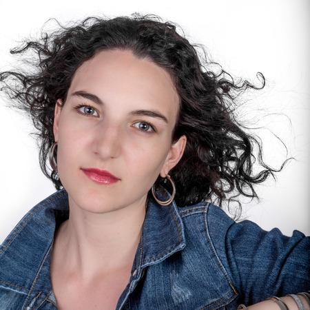 twentysomething: Portrait of a young female model in her mid twenties wearing a blue denim jacket.