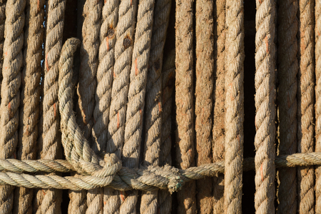 natural rope: Natural rope made of fibre as background with spliced eyes attached to each other. Stock Photo