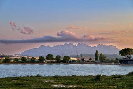 Parc de l'Agulla de Manresa, with the mountains of Montserrat at sunset with a nice cloud formation