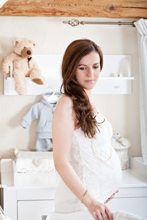 Portrait of the young pregnant woman Stock Photo