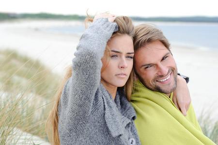 lovely couple: Romantic seaside lovely couple in sand dune - autumn, beach Stock Photo