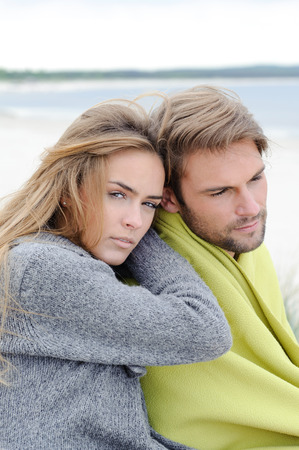 sea grass: Couple embracing each other at the beach - autumn sea, sand dune, sea grass