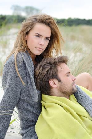 enjoying life: Happy healthy pair outdoors enjoying life - sand dune, autumn, beach