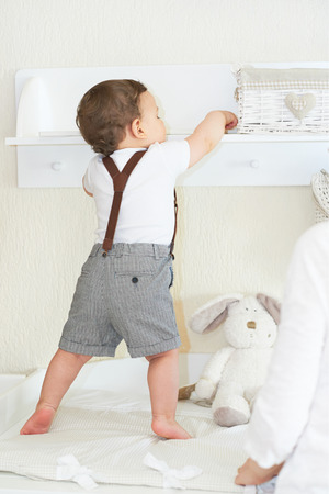 Lovely and cute baby boy playing at home and having nice time Stock Photo