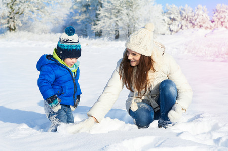 Happy family on the walk in sunny, snowy day - winter holidays Stock Photo