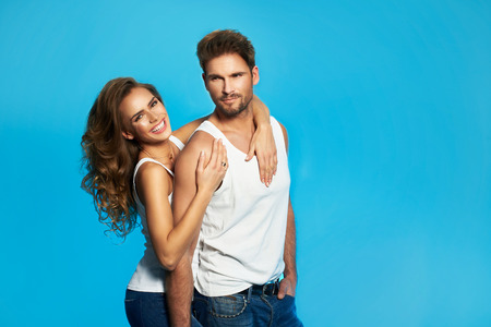 Young couple in white undershirts loving each other Stock Photo