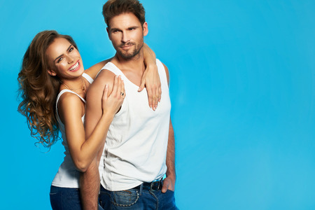 Foto di bella coppia su sfondo blu Archivio Fotografico - 36890832