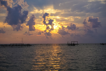 A Sunrise over the Bay with pier destruction in Rockport Texas after Hurricane Harvey Stock Photo