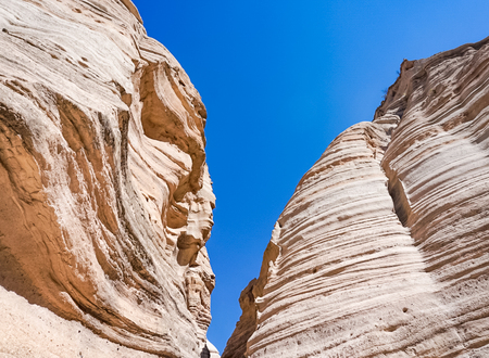 Looking up from the canyons of the Kasha-Katuwe Tent Rocks National Monument near Cochiti Pueblo, New Mexico