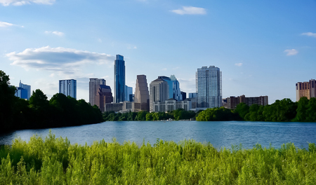 A Skyline View of Downtown Austin, Texas from the boardwalk and hiking trail around Lady Bird Johnson Lake