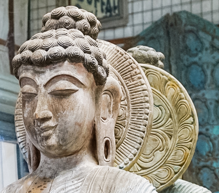 An up close view of a Buddhist Statue Meditating and Reflection