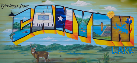 CANYON LAKE, TEXAS - MARCH 31, 2018 -Greetings from Canyon Lake Mural with landmarks and landscape on the side wall of the Wildflower Artisan Flour Bakery by K Hammond