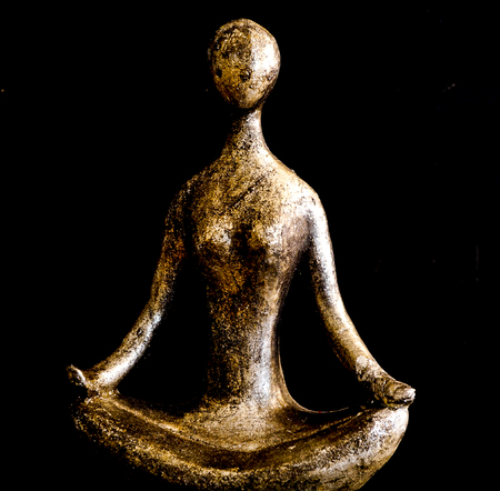 Simple Gold and Silver Body Form in Lotus Position with black background