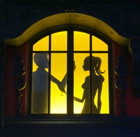 Las Vegas, Nevada: May 11, 2018:  A window lit up with shadows of people drinking inside the Paris Hotel and Casino