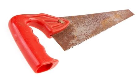 serrucho: Old corte transversal sierra de mano con mango de pl�stico rojo Foto de archivo