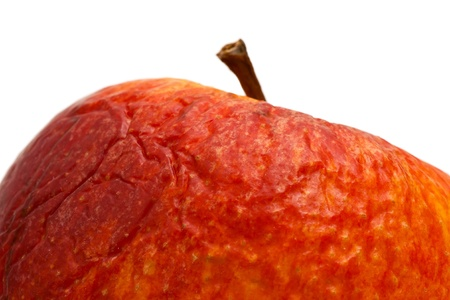 Close up of an old apple on a white background