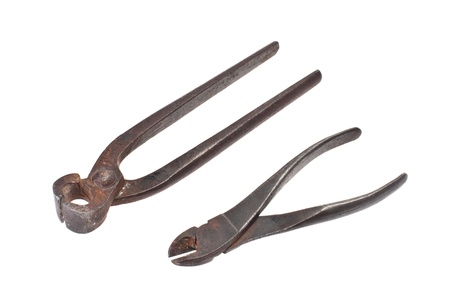 pincers: Pairs of old pincers and nippers on a white background