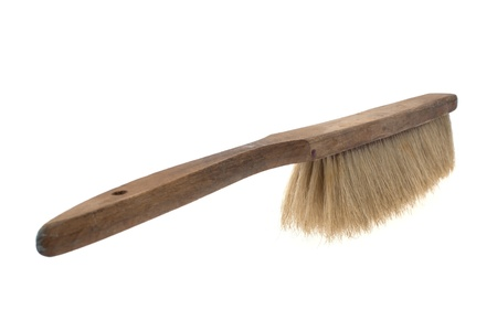 Old pig hair hand broom isolated on white photo