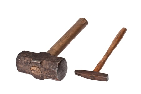 A sledge hammer and a list hammer, both old and rusty, isolated on a white background photo